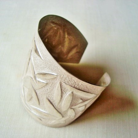 bracelet in sterling silver made with the chasing and repoussé.