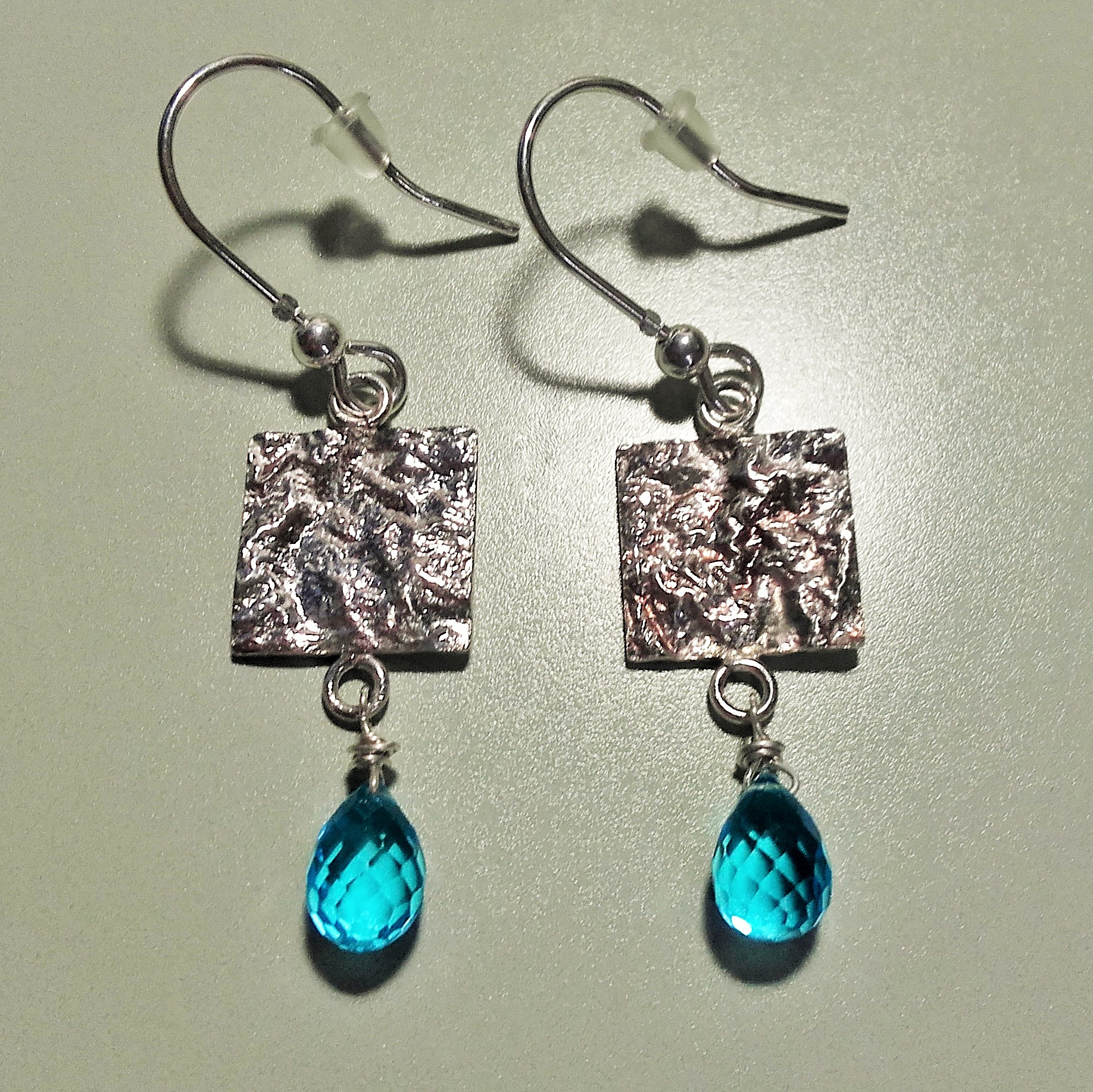 earings in reticulated silver with blue topaz drops